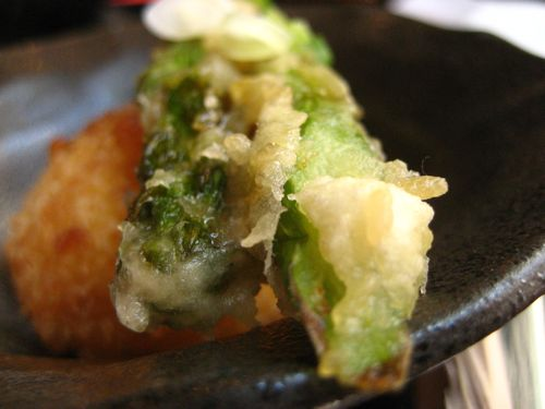 Tempura asparagus spears on HALF a fried egg