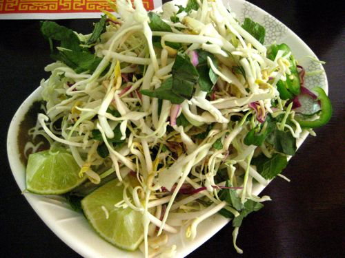 Vietnamese soups always come with veggies & limes.  If you see lemons or nothing at all, leave.